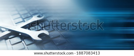Electronic technical support concept. Wrenches  Royalty-Free Stock Photo #1887083413