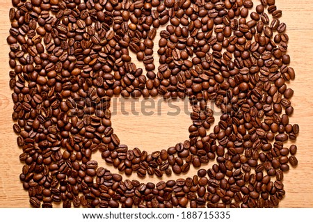 cup of coffee beans on wooden background #188715335