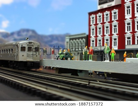 A simulation of an arriving commuter train using a model train layout. Royalty-Free Stock Photo #1887157372
