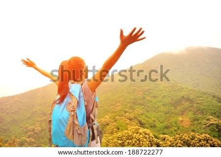 cheering hiking woman enjoy the beautiful view at mountain peak  #188722277