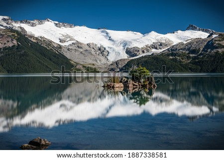 Island with a tree on Garibaldi Lake, garibaldi provincial park, canada  Royalty-Free Stock Photo #1887338581