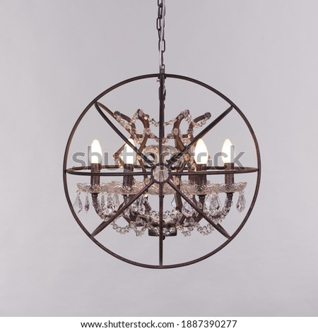 Elegant Hanging Chandelier with lit E-14 bulbs holder full framed picture in grey background