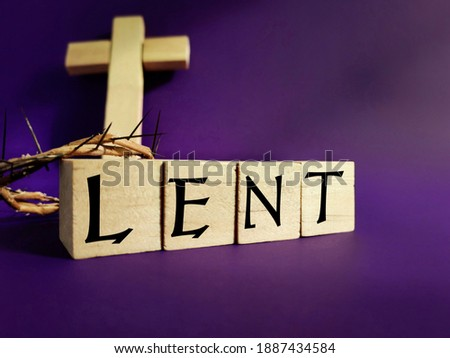 Lent Season,Holy Week and Good Friday concepts - word LENT on wooden blocks in purple color background. Stock photo.