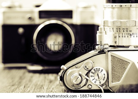 Detail view of classic cameras in monochrome vintage style