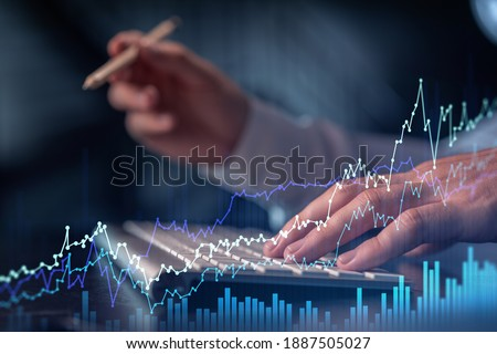 Hands typing the keyboard to research stock market to proceed right investment solutions. Internet trading and wealth management concept. Formal wear. Hologram Forex chart over close up shot.