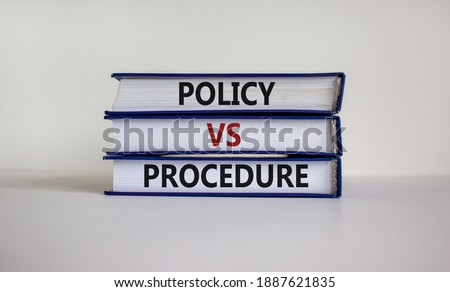 Policy vs procedure symbol. Books with words 'Policy vs procedure' on beautiful white table, white background. Business and policy vs procedure concept, copy space. Royalty-Free Stock Photo #1887621835