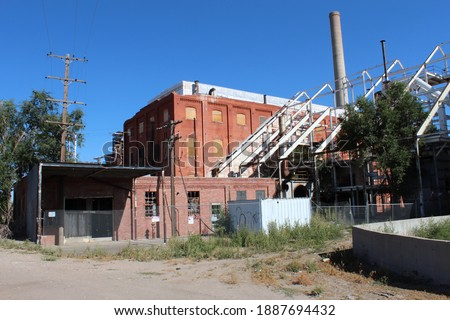 Old sugar beet factory abandoned.  Derelict building in Ault, CO.  Condemned factory in shambles. Royalty-Free Stock Photo #1887694432