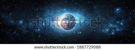 Panoramic view of the Earth, sun, star and galaxy. Sunrise over planet Earth, view from space. Concept on the theme of ecology, environment, Earth Day. Elements of this image furnished by NASA. Royalty-Free Stock Photo #1887729088