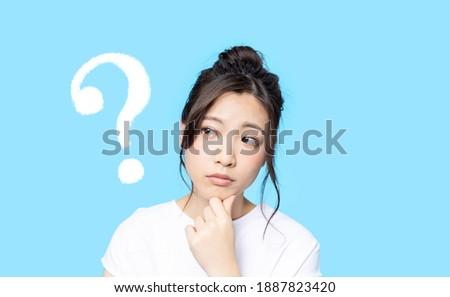 Thinking asian woman. Facial expression.
