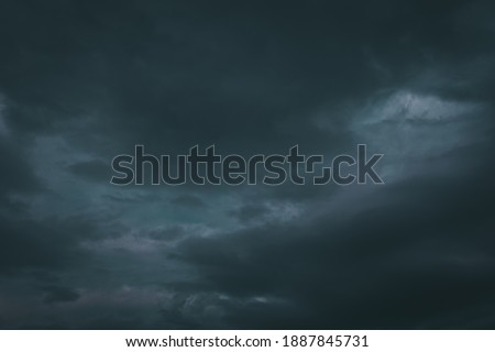 picture of thunderstorm clouds starting to pour rain and lightning.