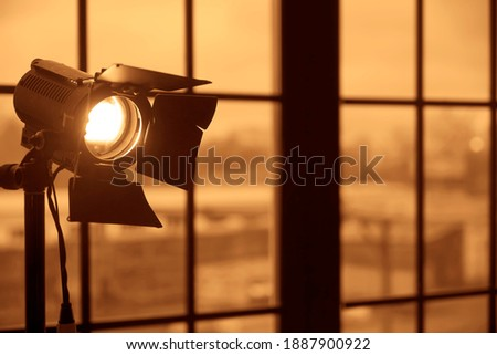 Photography studio on window background with lamp. Professional lighting equipment for video production. constant light