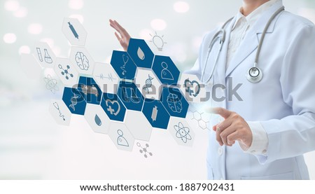 healthcare and medicine technology service concept. doctor diagnose disease with virtual screen interface with medical network hub. Royalty-Free Stock Photo #1887902431