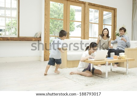 family relaxing in living room #188793017