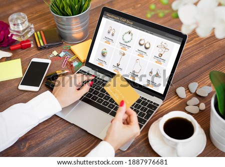 Woman shopping for hand made jewelry online Royalty-Free Stock Photo #1887976681