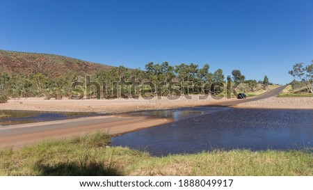 Australia, Crossing the Finke River in a Ford Royalty-Free Stock Photo #1888049917