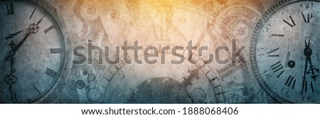 The dials of the old antique classic clocks on a vintage wide paper background. Concept of time, history, science, memory, information. Retro style. Vintage clockwork background. Royalty-Free Stock Photo #1888068406