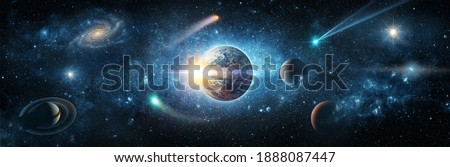 View from space to the planet Earth, galaxies, stars, comet, asteroid, meteorite, nebula, Saturn. Cosmic panorama of the universe. Space travel fantasy. Elements of this image furnished by NASA Royalty-Free Stock Photo #1888087447