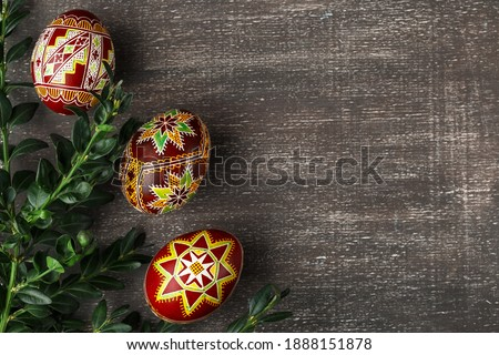 Handmade Easter eggs. Ukrainian pysanka decorated with wax-resist dyeing technique. Grey shabby background with copy empty space for text Royalty-Free Stock Photo #1888151878