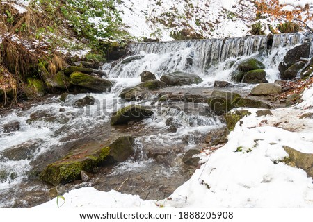 Closeup of the rapid mountain river. Fast water stream in mounta #1888205908