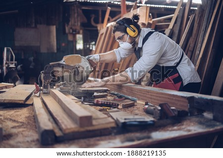 Artisan man Small factory industry, handicraft manufacturer, furniture professional in woodworking. Craftman working workshop maker construction. Royalty-Free Stock Photo #1888219135
