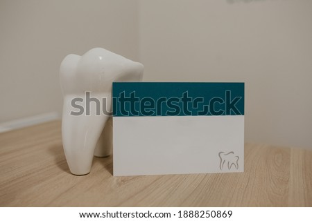 business card of the dentist