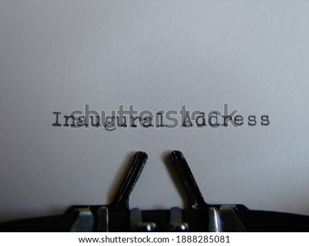 """the words """"inaugural address"""" typed on a typewriter, close up"""
