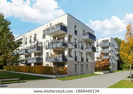 Residential area with ecological and sustainable green residential buildings, low-energy houses with apartments and green courtyard Royalty-Free Stock Photo #1888460134