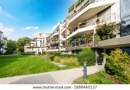 Residential area with ecological and sustainable green residential buildings, low-energy houses with apartments and green courtyard Royalty-Free Stock Photo #1888460137