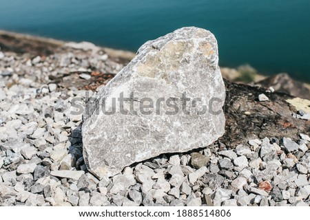 Big granite rock stone on. Natural stone. Grey, black and white granite texture, granite surface and background. Material for decoration texture, interior design