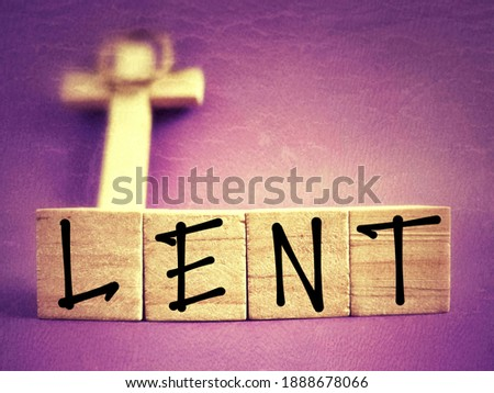 Lent Season,Holy Week and Good Friday concepts - LENT text on wooden blocks in purple vintage background. Stock photo.