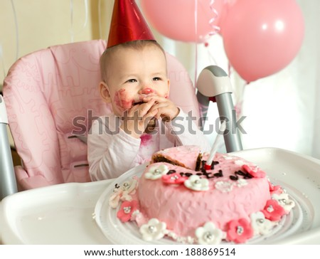 one-year-old little girl solemnize birthday, happy laughter, horizontal photo