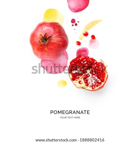 Creative layout made of pomegranate on the watercolor background. Flat lay. Food concept. Royalty-Free Stock Photo #1888802416