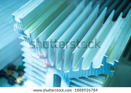 Aluminum profile close-up. Radiator profile made of aluminum. Computer cooler made of aluminum. Royalty-Free Stock Photo #1888926784