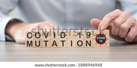 Concept of Covid-19 mutation on wooden cubes Royalty-Free Stock Photo #1888946968