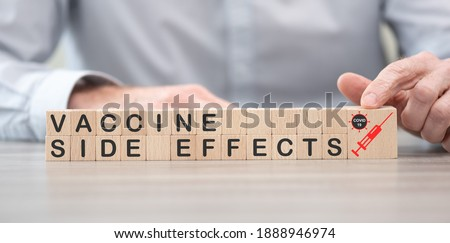 Concept of Covid-19 vaccine side effects on wooden cubes Royalty-Free Stock Photo #1888946974