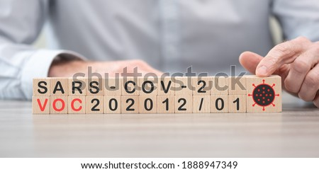 British variant of SARS-CoV-2: VOC-202012 01 on wooden cubes Royalty-Free Stock Photo #1888947349