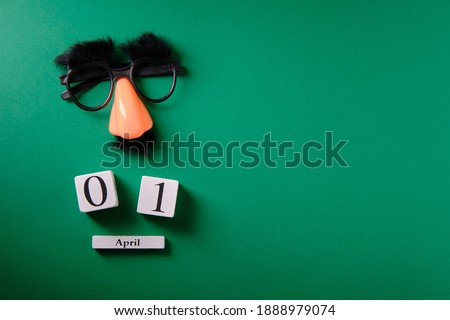Mustache overhead glasses, April 1, joke, April fools day Royalty-Free Stock Photo #1888979074