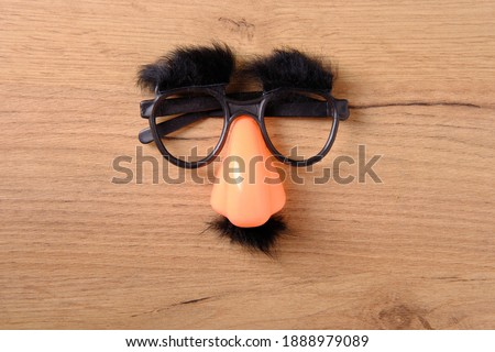 Overhead glasses with mustache, April 1, joke, fools day, top view, close-up Royalty-Free Stock Photo #1888979089