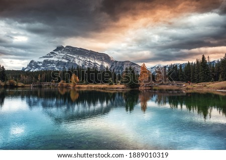 Cascade ponds with mount rundle and wooden bridge in autumn forest at Banff national park, Canada. Dranatic Tone Royalty-Free Stock Photo #1889010319