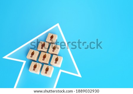 A group of people form a single movement arrow. Consolidation, striving for a common goal. Organization and cooperation. Strength in unity, teamwork. Joint achievement of goals and tasks. Unity. Royalty-Free Stock Photo #1889032930