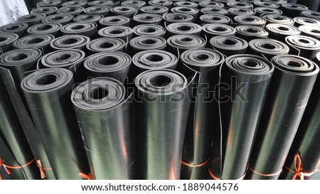 warehouse rolls of rubber. black coating rolls. Royalty-Free Stock Photo #1889044576