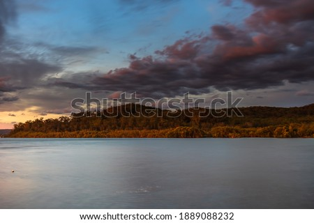 Sunset waterscape with clouds at Yattalunga on the Central Coast of NSW, Australia. Royalty-Free Stock Photo #1889088232