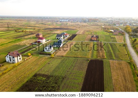 Aerial view of home roofs in residential rural neighborhood area. Royalty-Free Stock Photo #1889096212