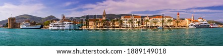 Historic buildings on promenade in Trogir, Croatia. Trogir is popular travel destination in Croatia. Trogir, as a UNESCO World Heritage Site, is one of most visited places in Dalmatia, Croatia. Royalty-Free Stock Photo #1889149018
