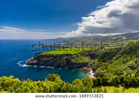 Azores panoramic view of natural landscape, wonderful scenic island of Portugal. Beautiful lagoons in volcanic craters and green fields. Tourist attraction and travel destination. Azores, Portugal. Royalty-Free Stock Photo #1889153821