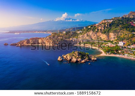 Taormina is a city on the island of Sicily, Italy. Mount Etna over Taormina cityscape, Messina, Sicily. View of Taormina located in Metropolitan City of Messina, on east coast of Sicily island, Italy. Royalty-Free Stock Photo #1889158672
