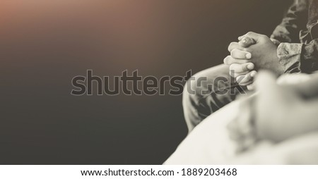 man praying worship at home on black background.Teenager hand praying,Hands folded in prayer.Good friday, Easter, forgiveness.Concept for faith, people, fasting and religion.stay home, lockdown.