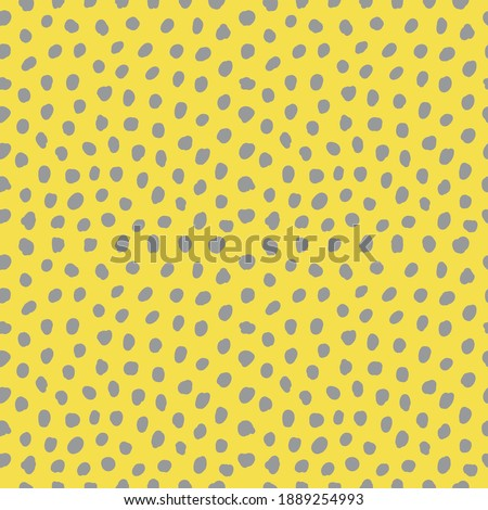 Abstract seamless pattern with dots. Ultimate gray polka dots on illuminating yellow background. 2021 Year color trends.  Royalty-Free Stock Photo #1889254993