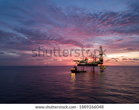Aerial view offshore drilling rig (jack up rig) at the offshore location during sunset Royalty-Free Stock Photo #1889266048