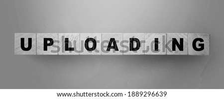 uploading word on wooden cubes. Online downloadable Internet resources concept